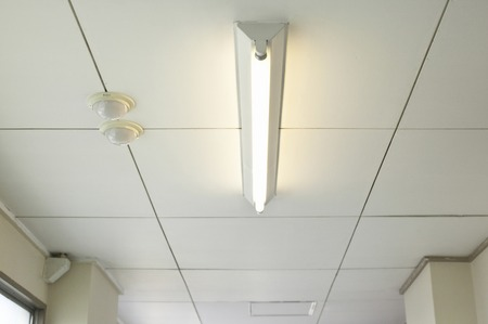 power within: Fluorescent lights of the corridor Stock Photo