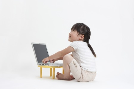 salubrious: Girl mucking laptop Stock Photo