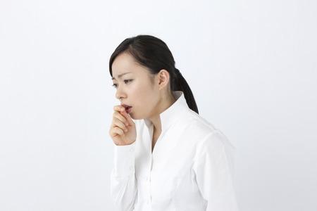 Female cough Stockfoto