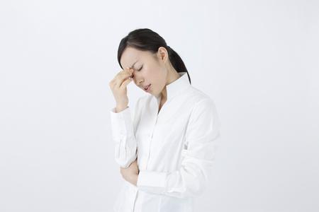 疲労を感じる女性 写真素材