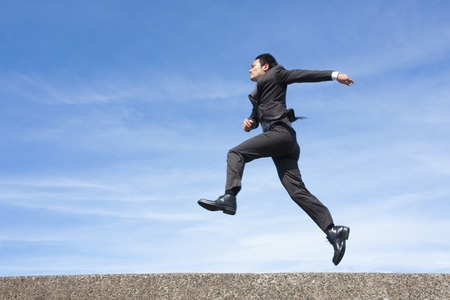 consign: Businessman jumping