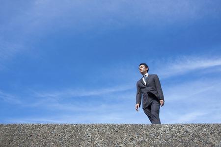 despatch: Blue sky and businessman Stock Photo