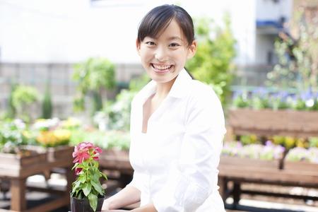 clerk: Female flower shop clerk Stock Photo