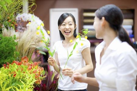 Female flower shop clerk and customer