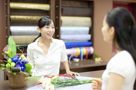 clerk: Female flower shop clerk and customer