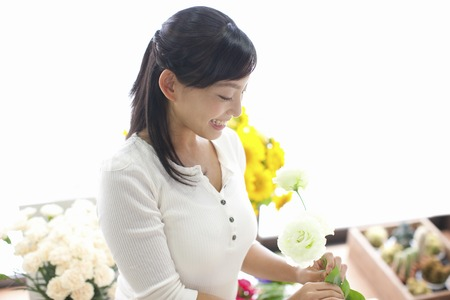 Rose took a smiling woman Stock Photo