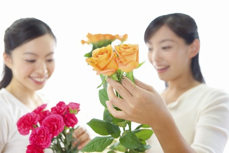 2 women to see the flower Stock Photo