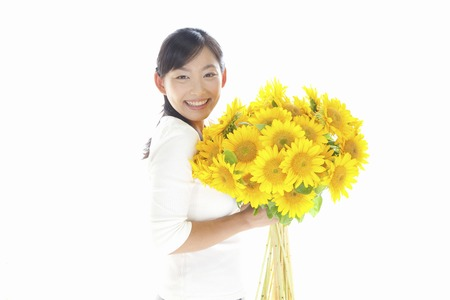 Woman with a bouquet of sunflowers