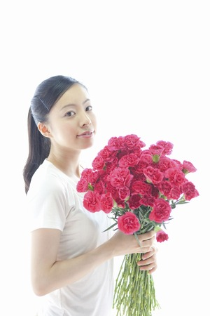 carnations: Lady with carnations Stock Photo