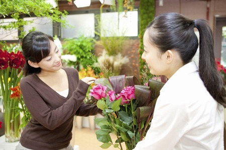 Store clerk with a bouquet Stock Photo