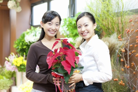 shopping buddies: 2 females with a poinsettia