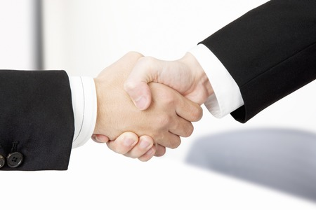 Shaking hands Фото со стока