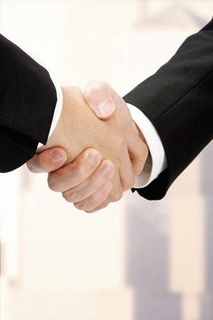 collaborator: Shaking hands Stock Photo