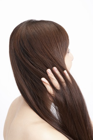 back view of man: Touch the straight hair female