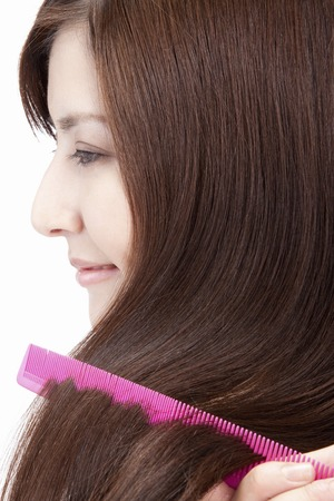 coherence: Women especially the hair with a comb Stock Photo