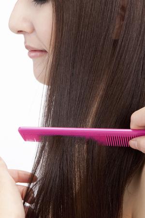 especially: Women especially the hair with a comb Stock Photo