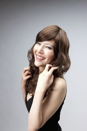 dress up: Woman wearing a wig Stock Photo