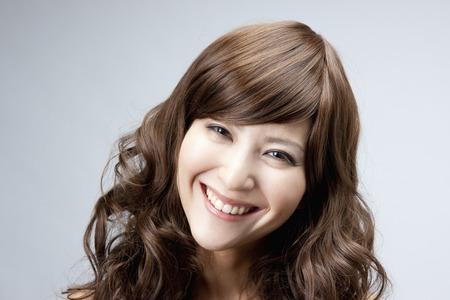 Woman wearing a wig 写真素材