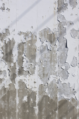 peeled off: wall of concrete that paint has peeled off