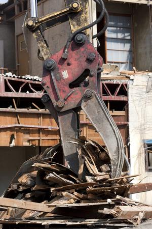 power shovel: Dismantling construction of houses