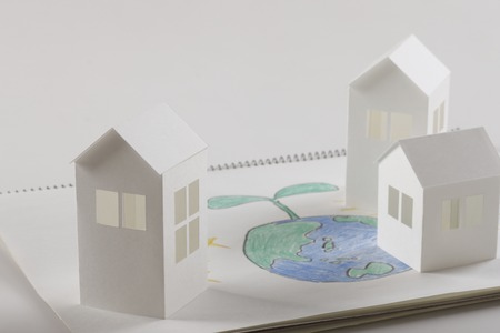 family moving house: Earth Moon and Sun picture and paper House Stock Photo
