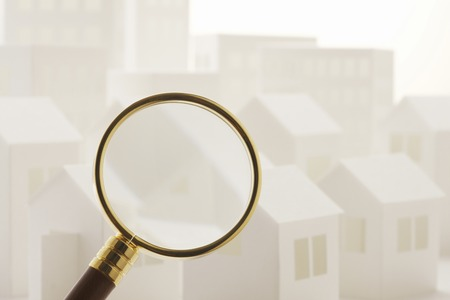 glass paper: Paper Craft of house and building and magnifying glass Stock Photo