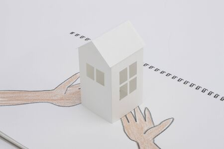 family moving house: Paper Craft House and illustrations of hand