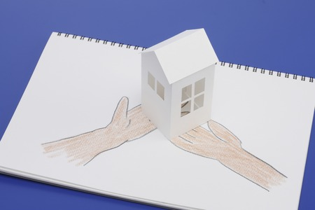 scaled down: Paper Craft House and illustrations of hand
