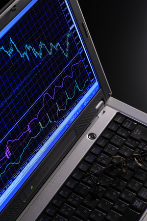 stock: Stock prices and laptop Stock Photo