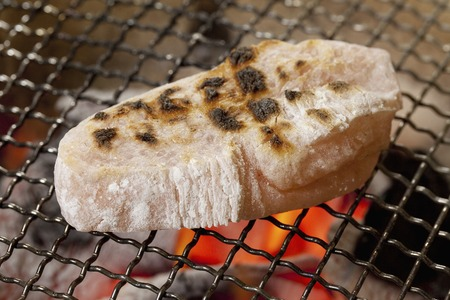 rice   cake: Shrimp rice cake to bake in earthen charcoal brazier Stock Photo