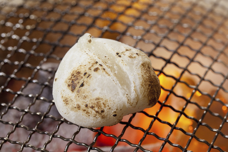 rice   cake: Rice cake that is baked in earthen charcoal brazier