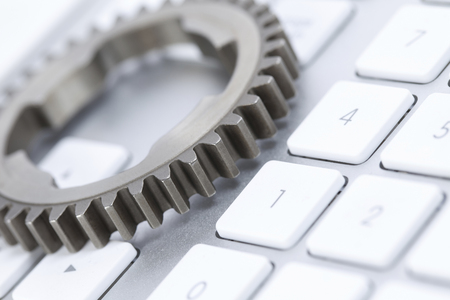 pc: Gear and PC keyboard Stock Photo