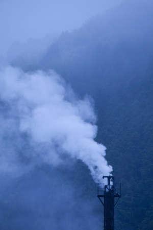 sawmill: Chimney and smoke of sawmill Stock Photo