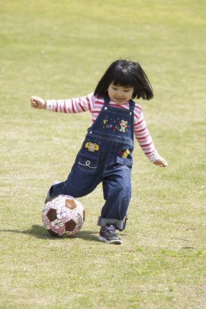 football play: Girl to play ball Stock Photo