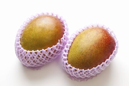 cushioning: Mango wrapped in cushioning material Stock Photo