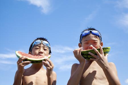 two stroke: Boy eating watermelon