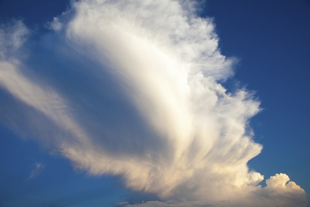 the natural phenomena: Towering cloud in summer flows in the wind Stock Photo