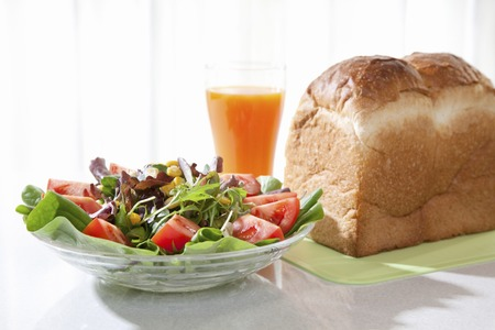 potherb: Salad and vegetable juice and bread breakfast
