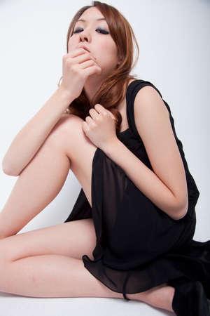 one piece dress: Woman in a black dress