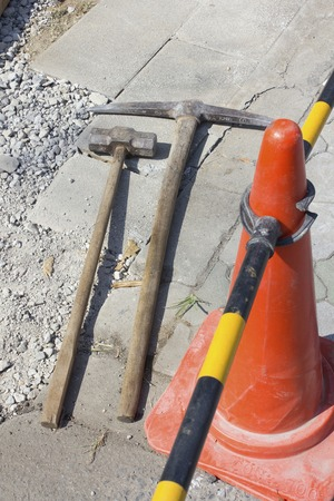 pickaxe: Construction site of the pickaxe and hammer Stock Photo