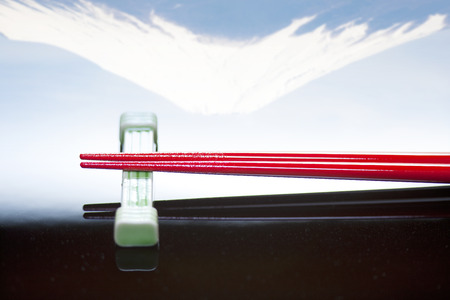 upside down: Upside down Fuji and chopsticks Stock Photo