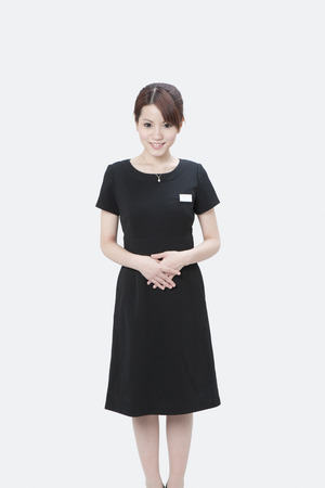 one piece dress: Female image in the hospitality industry Stock Photo