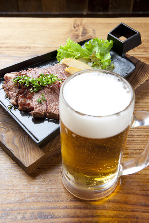 draft beer: Draft beer and steak Stock Photo