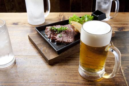 draft beer: Draft beer and steak Stock Photo