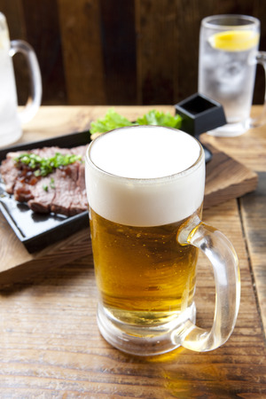 draft: Draft beer and steak Stock Photo