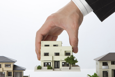 land use: Businessman with a model House