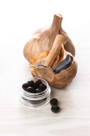 healthiness: Black garlic supplements Stock Photo