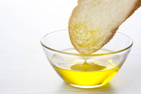 French bread and olive oil Imagens