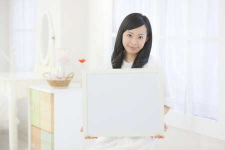 Woman with a white board Stock Photo