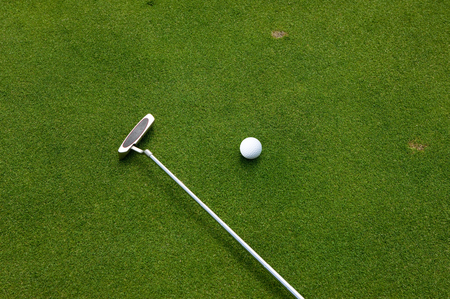 putter: Putter and golf ball Stock Photo